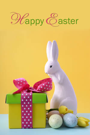 cute text box: Cute Easter Bunny with bright color gift box on yellow and blue background, with sample text.