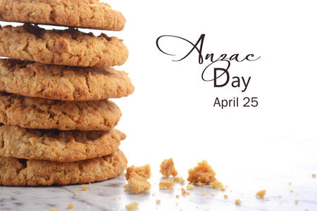 ANZAC Day, April 25, traditional Anzac biscuits on white marble table closeup with copy space.