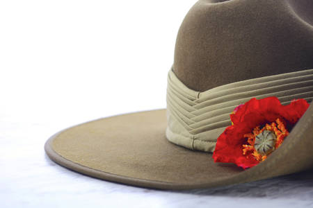 ii: ANZAC Day, April 25, army slouch hat on white marble table with copy space.