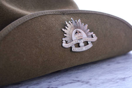anzac: ANZAC Day, April 25, army slouch hat on white marble table, closeup.