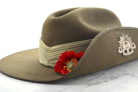 ANZAC Day, April 25, army slouch hat on white marble table.