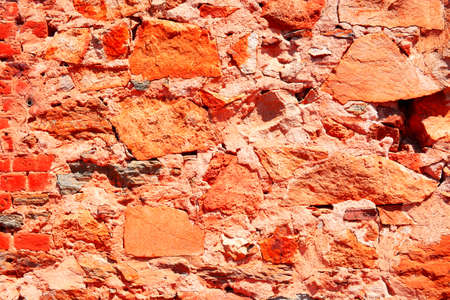 ornage: Old rustic brick wall background made from sandstone, in red ornage tones.