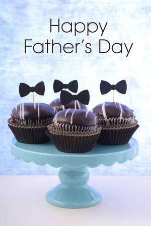 cake stand: Happy Fathers Day cupcakes on cake stand against a blue background. Stock Photo