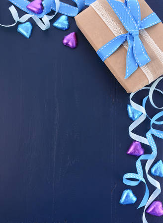 candy border: Happy Fathers Day background on dark blue distressed wood table with decorated borders.