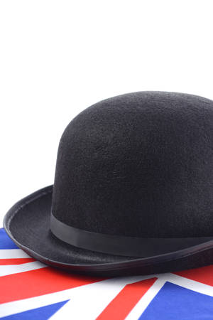 English UK events concept with bowler hat and Union Jack flag against a white background.