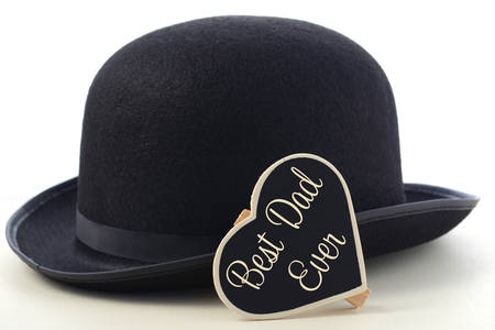 Fathers Day concept with mens black bowler hat and Best Dad Ever blackboard  greeting on a 6ba7695f625