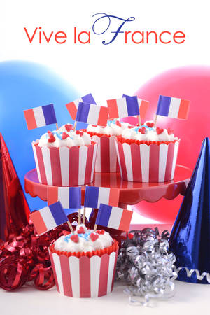 bastille: Happy Bastille Day cupcakes in bright red, white and blue party setting.