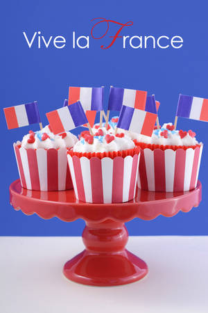 bastille: Happy Bastille Day red, white and blue cupcakes on red cakestand on blue and white background.