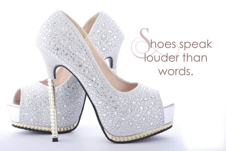 louder: High Heel rhinestone stiletto shoes with funny saying, Shoes Speak Louder than Words. Stock Photo