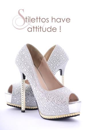 rhinestone: High Heel rhinestone stiletto shoes with funny saying, Stilettos have attitude. Stock Photo