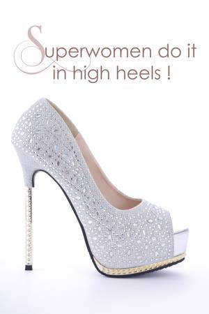 rhinestone: High Heel rhinestone stiletto shoe with funny saying, Superwomen do it in high heels. Stock Photo