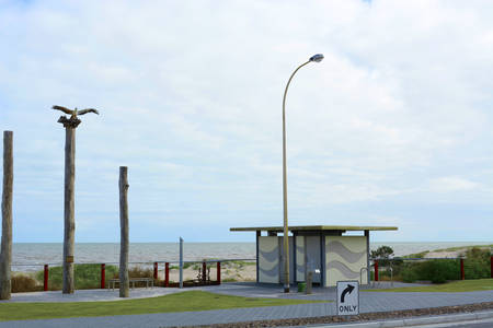 sea eagle: Entrance to Henley Beach, South Australia, with the sea eagle sculpture on top of wood pylons.