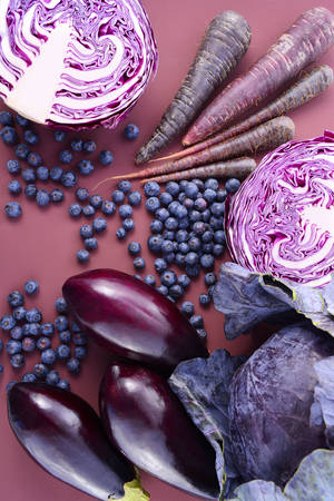 Purple fruits and vegetables thay contain Anthocynins, found in the Okinawan diet, that maintain healthy blood vessels and promote longevity. Stock Photo