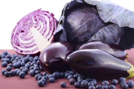 longevity: Purple fruits and vegetables thay contain Anthocynins, found in the Okinawan diet, that maintain healthy blood vessels and promote longevity. Stock Photo