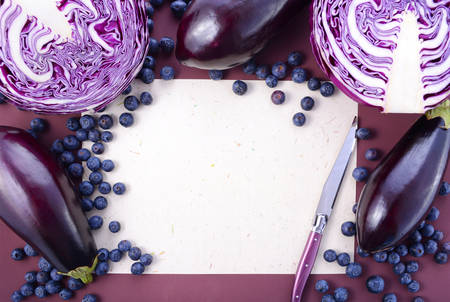 Purple fruits and vegetables thay contain Anthocynins, found in the Okinawan diet, that maintain healthy blood vessels and promote longevity, with copy space. 스톡 콘텐츠