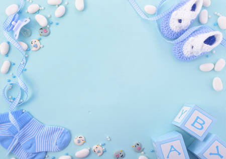 Its a boy, blue theme Baby Shower or Nursery background with decorated borders on pale blue wood background. Foto de archivo