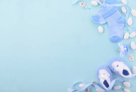 Its a boy, blue theme Baby Shower or Nursery background with decorated borders on pale blue wood background. Stockfoto
