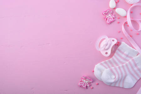 Its a Girl pink theme Baby Shower or Nursery background with decorated borders on pink wood background. Reklamní fotografie - 60926686