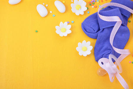baby shower yellow: Baby Shower or Nursery background with decorated borders on a yellow wood background. Stock Photo