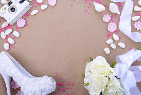 Wedding background with decorated borders and copy space on natural brown paper background.