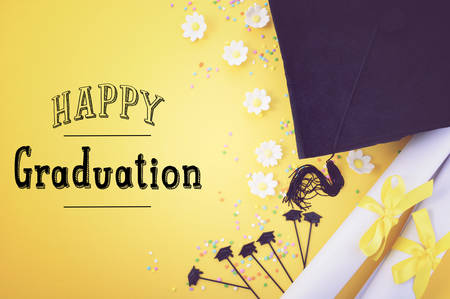 Yellow black and white theme graduation background with decorated borders on yellow background, with applied retro style filters and added handdrawn style text. Foto de archivo