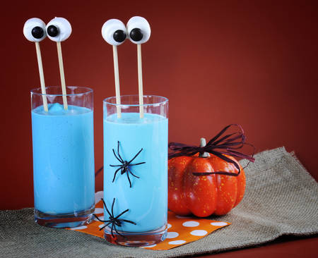 ghoulish: Happy Halloween marshmallow extended martian eyes in blue banana smoothie for fun party drinks, with copy space. Stock Photo