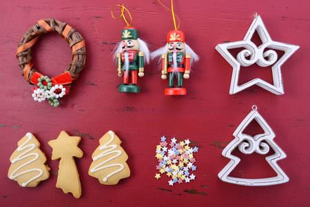 happy christmas: Happy Holidays Christmas background flat lay with ornaments on a red rustic wood background.