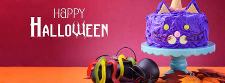 placeholder: Happy Halloween cat cake party food with purple frosting, sized to fit a popular social media cover image placeholder.