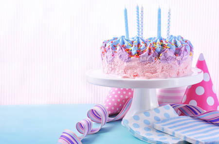 children birthday: Childrens pink and blue ice cream birthday cake with candles. Stock Photo