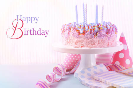 pink cake: Childrens pink and blue ice cream birthday cake with candles. Stock Photo