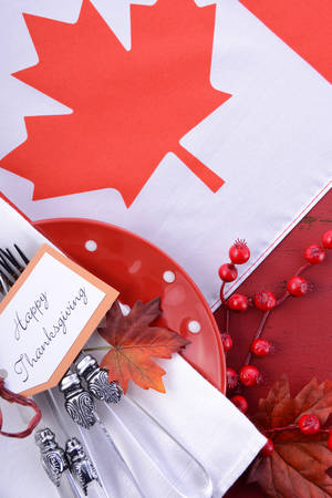 canadian maple leaf: Canada red and white theme Thanksgiving background with decorated borders on a distressed red wood table, with Canadian Maple Leaf Flag.