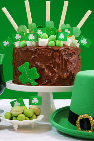 saint patrick's: Happy St Patricks Day, March 17, green and white party table with showstopper chocolate cake decorated with candy, cookies and shamrock flags.