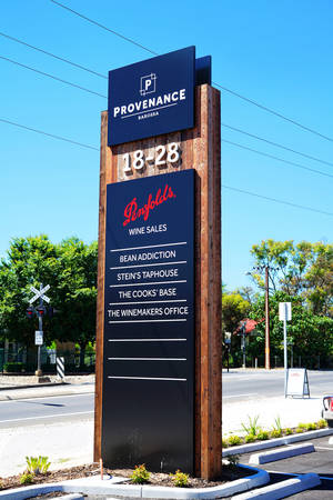 exporter: BAROSSA VALLEY, SOUTH AUSTRALIA - JANUARY 3, 2017: Road signage to Penfolds Wines, South Australia premium wine producer and exporter wine and sales center.