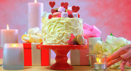 Setting party table with showstopper cake for Mothers Day, Valentines, Wedding or feminine birthday party.