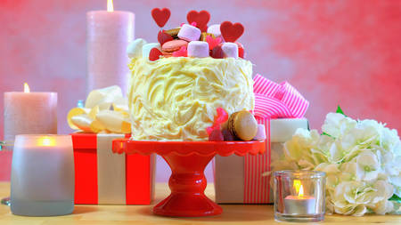 womens hands: Setting party table with showstopper cake for Mothers Day, Valentines, Wedding or feminine birthday party.