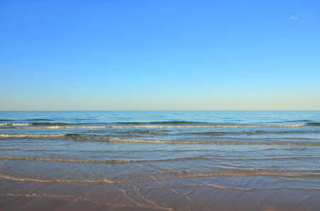 adelaide: Beautiful wide open Australian beach at early morning in Summer at low tide.