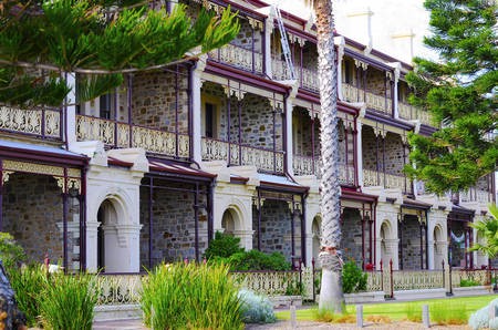 Row of Victorian bluestone and sandstone three story terraces, the Marines, overlooking Henley Beach, South Australia. Stock Photo