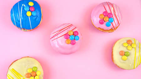 Pop Art Color style donuts and bakery goodies on bright colorful background.