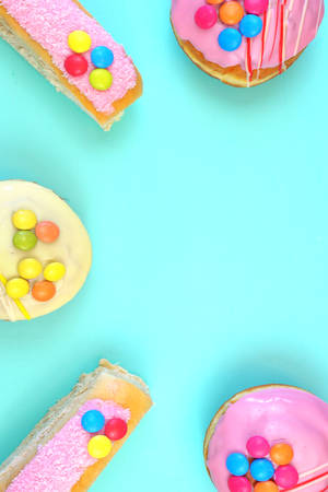 Pop Art Color style donuts and bakery goodies on bright colorful background, vertical with copy space.