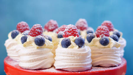 Australian mini pavlovas and flags in red, white and blue for Australia Day or national holiday party food treats.