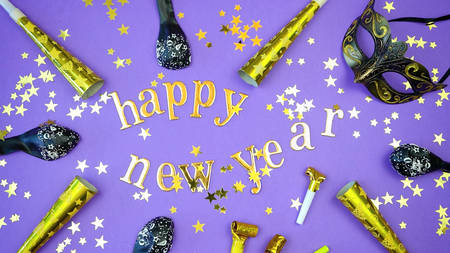 Happy New Year gold letters and numbers bunting and decorations on 2018 color of the year, ultra violet, background .