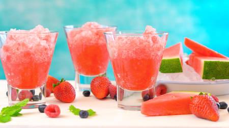 Preparing Summertime refreshing Watermelon granita desserts on a blue and white background. Stock Photo