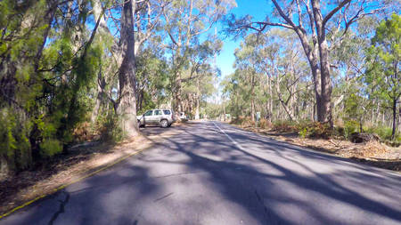 Vehicle POV, driving through Mount Lofty Summit, Adelaide Hills, South Australia. Stock Photo