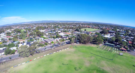 Drone footage of Australian public park and sports oval, taken at Henley Beach, South Australia.