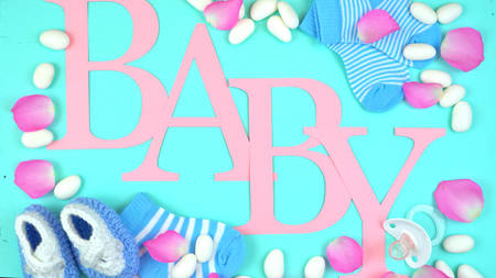 Pink and blue baby overhead decorated by nursery accessories and letters spelling the word, Baby. Stock Photo