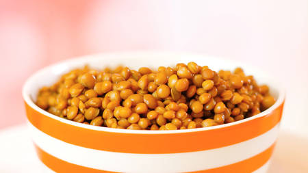 Lentil beans, healthy source of dietary fibre and protein, in bowl closeup with copy space. Stock Photo