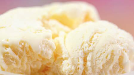 Refreshing summertime vanilla ice cream macro closeup.