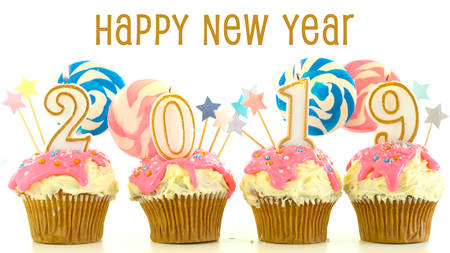 2019 Happy New Years candy land lollipop drip cupcakes on white background with text greeting.