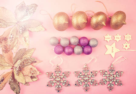 Colorful Christmas overhead in modern pink, gold and silver theme gift and ornaments with applied retro vintage style filters.