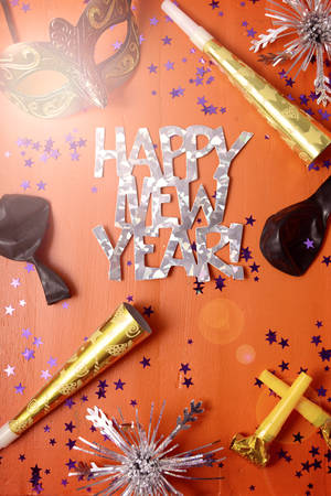 Happy New Year Party Decorations on dark wood table   with applied filters and lens flare. 스톡 콘텐츠
